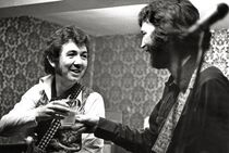 Ronnie and Eric Clapton playing the Drum And Monkey in Shropshire in 1977 (Image credit: Rex)