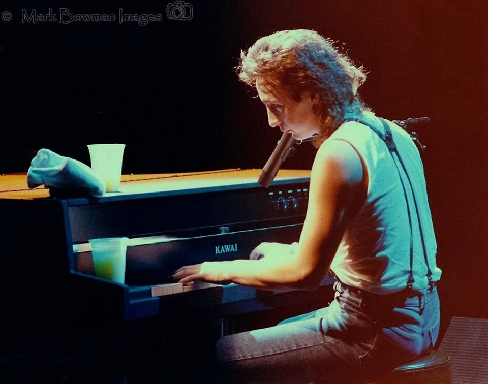 Mark Bowman Images- Julian Lennon at keyboards The Music Hall - Houston Texas March 27 1985