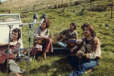 Ronnie Lane working in the grass with Slim Chance